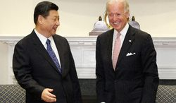 Vice President Joe Biden meets with Chinese Vice President Xi Jinping in the Roosevelt Room at the White House in Washington, Tuesday, Feb. 14, 2012. (AP Photo/Charles Dharapak)