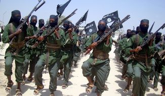 Al-Shabab fighters march with their weapons during military exercises on the outskirts of Mogadishu, Somalia, in February 2011. Over the past year, al-Shabab has lost much of the territory it held.  (Associated Press)