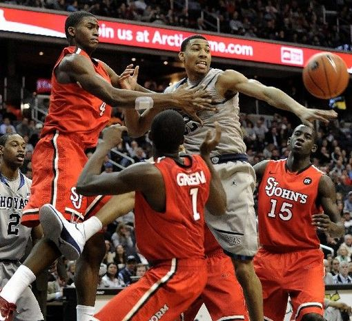 Associated Press Georgetown forward Otto Porter (center) fights for a loose ball during the Hoyas' 71-61 win over St. John's on Sunday at Verizon Center.