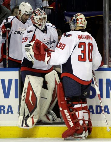 Capitals goaltender Tomas Vokoun (left) has relegated Michal Neuvirth, Washington's starter in the playoffs last year, to the bench for much of this season. Neuvirth has struggled as a backup, compiling a .894 save percentage and 3.07 goals-against average. (Associated Press)