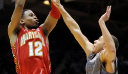 **FILE** Maryland's Terrell Stoglin (12) shoots over Duke's Seth Curry during the Terps' 73-55 loss at Duke on Feb. 11, 2012. (Associated Press)