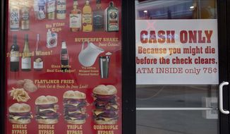 "The Heart Attack Grill in Las Vegas offers such fare as ""bypass"" burgers, ""flatliner"" fries and ""butterfat"" shakes on its menu. (AP Photo/Julie Jacobson)"