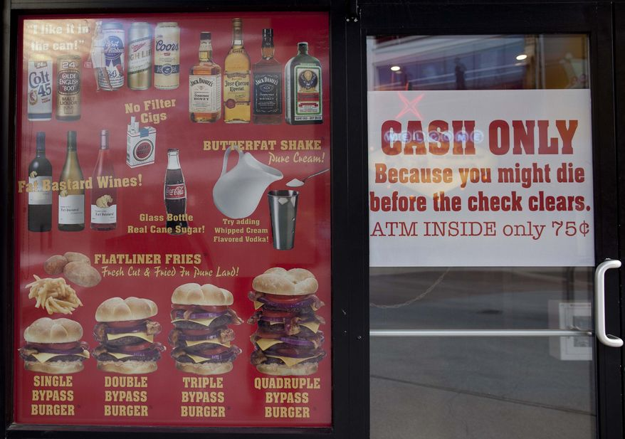 """The Heart Attack Grill in Las Vegas offers such fare as """"bypass"""" burgers, """"flatliner"""" fries and """"butterfat"""" shakes on its menu. (AP Photo/Julie Jacobson)"""