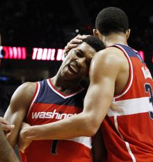 Washington Wizards guard Nick Young hugged by teammate JaVale McGee after their game against the Portland Trail Blazers in Portland, Ore., Tuesday, Feb. 14, 2012. Young sank 7 of 8 3-point shots while scoring 35 points to lead the Wizards to a 124-109 win over the Blazers.(AP Photo/Don Ryan)
