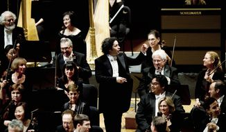 Conductor Gustavo Dudamel, 31, is a national hero in Venezuela. Outside the concert hall where the Los Angeles Philharmonic performed, vendors sold T-shirts and buttons emblazoned with his image. (Associated Press)