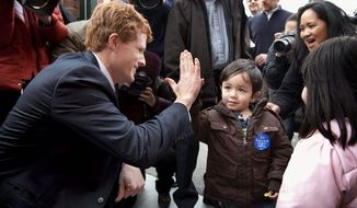 Joseph Kennedy III exchanges a greeting with 3-year-old Matthew Olsen, of Attleboro, Mass., during a campaign stop Thursday. Mr. Kennedy is running for the congressional seat held by retiring U.S. Rep. Barney Frank. (Associated Press)