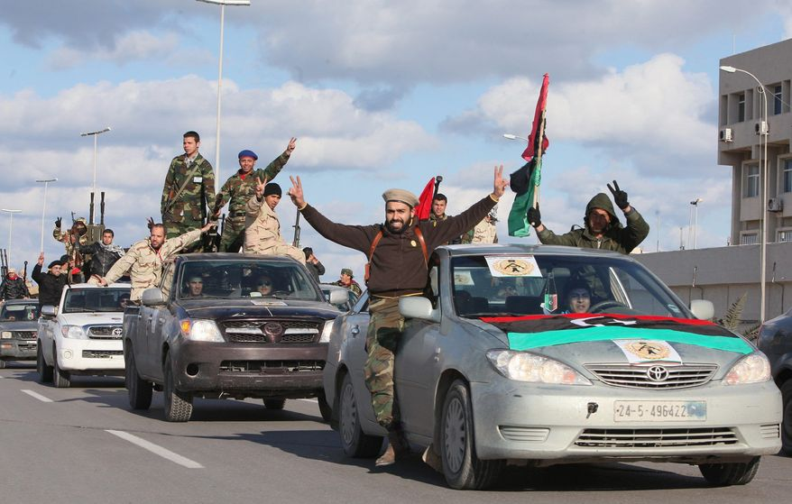 **FILE** Libyan militias from towns throughout the country's west parade through Tripoli, Libya, on Feb. 14, 2012. (Associated Press)