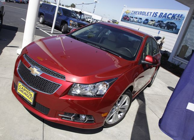 **FILE** A 2011 Chevrolet Cruze is featured Aug. 30, 2011, at a car dealership in San Jose, Calif. (Associated Press)