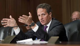 ** FILE ** Treasury Secretary Timothy F. Geithner testifies on Capitol Hill in Washington on Tuesday, Feb. 14, 2012, before the Senate Finance Committee hearing on President Obama's fiscal 2013 federal budget. (AP Photo/J. Scott Applewhite)