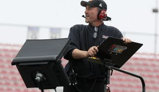 FILE - In this Oct. 30, 2009 file photo, crew chief Steve Addington watches practice for the NASCAR Sprint Cup Series AMP Energy 500 auto race at Talladega Superspeedway in Talladega, Ala. Addington is the new crew chief for Tony Stewart. (AP Photo/John Bazemore, File)