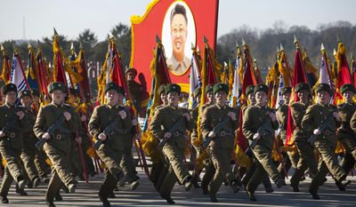 North Korean soldiers goose-step below a portrait of the late North Korean leader Kim Jong-il during a military parade at Kumsusan Memorial Palace in Pyongyang, North Korea, to commemorate Kim's 70th birthday on Thursday, Feb. 16, 2012. (AP Photo/David Guttenfelder)
