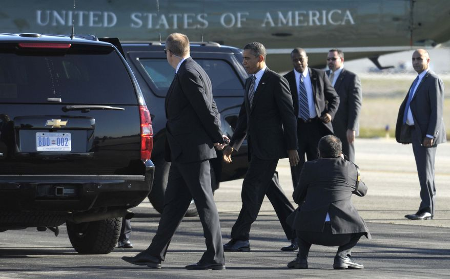 President Barack Obama walks off of Marine One at John Wayne Airport in Santa Ana, Calif., Thursday, Feb. 16, 2012, to attend a fundraiser. (AP Photo/Susan Walsh)