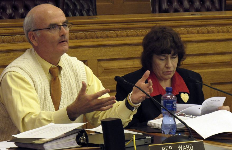 Kansas state Rep. Jim Ward (left), Wichita Democrat, asks questions during a House Judiciary Committee hearing on a bill that supporters will say will protect religious freedoms, as Rep. Jan Pauls (right) Hutchinson Democrat, follows the proceedings on Tuesday, Feb. 14, 2012, at the Statehouse in Topeka, Kan. (AP Photo/John Hanna)