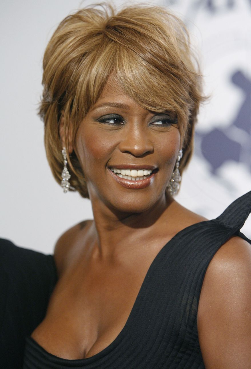 **FILE** Singer Whitney Houston arrives Oct. 28, 2006, at the 17th Carousel of Hope Ball benefiting the Barbara Davis Center for Childhood Diabetes in Beverly Hills, Calif. (Associated Press)