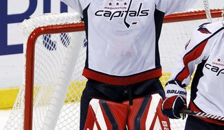 Washington Capitals goalie Tomas Vokoun celebrates after a 2-1 win against the Florida Panthers in Sunrise, Fla., Friday, Feb. 17, 2012. (AP Photo/Alan Diaz)