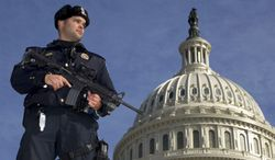 Capitol Police officer Angel Morales stands on guard Feb. 17, 2012, on the west side of the U.S. Capitol in Washington, after a 29-year-old Moroccan man was arrested in an FBI sting operation near the Capitol while planning to detonate what police say he thought were live explosives. (Associated Press)