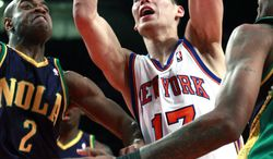 New York Knicks' Jeremy Lin drives past New Orleans Hornets' Jarrett Jack (2) and Trevor Ariza (1) during the first half Friday, Feb. 17, 2012, in New York. (AP Photo/Frank Franklin II)