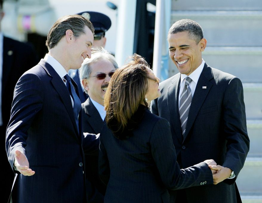 President Obama is greeted upon his arrival at San Francisco International Airport on Thursday for a series of fundraisers by (from left) California Lt. Gov. Gavin Newsom, San Francisco Mayor Ed Lee and California Attorney General Kamala Harris. (Associated Press)