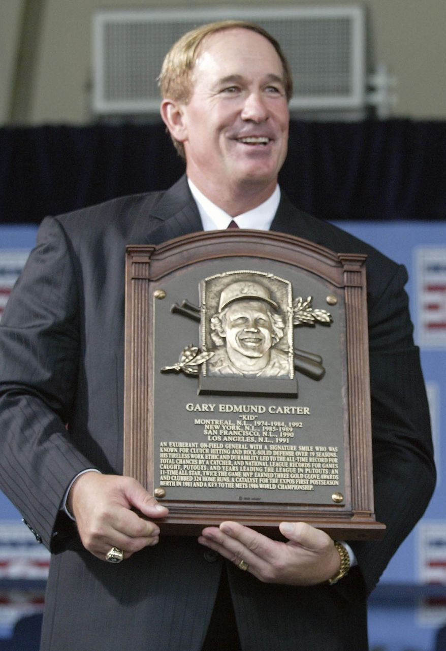 FILE - In this July 27, 2003, file photo, National Baseball Hall of Fame Inductees Gary Carter holds his plaque during induction ceremonies in Cooperstown, N.Y. Baseball Hall of Fame president Jeff Idelson said Thursday, Feb. 16, 2012, that Hall of Fame catcher Gary Carter has died. He was 57.(AP Photo/John Dunn, File)