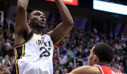 Utah Jazz center Al Jefferson shoots over Washington Wizards center JaVale McGee during the second half Friday, Feb. 17, 2012, in Salt Lake City. The Utah Jazz won 114-100. (AP Photo/Jim Urquhart)