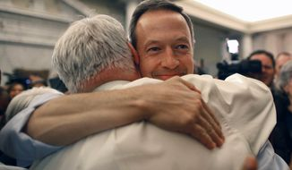 Maryland Gov. Martin O'Malley, right, hugs Speaker of the House of Delegates Michael Busch after the House passed a gay marriage bill in Annapolis, Md., Friday, Feb. 17, 2012. (AP Photo/Patrick Semansky)