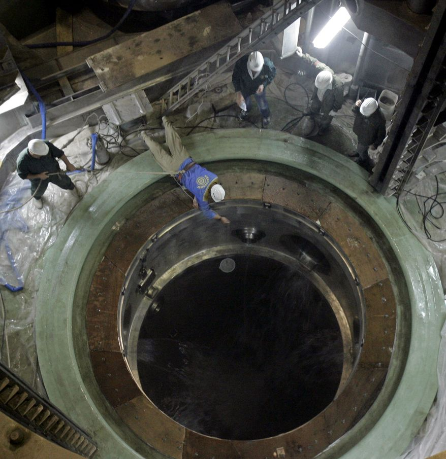 ** FILE ** In this Tuesday, April 3, 2007, file photo, technicians work at the reactor building of the Bushehr Nuclear Power Plant, some 750 miles (1,245 kilometers) south of the capital Tehran, Iran. (AP Photo/ISNA, Sot Akbar, File)