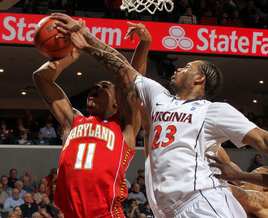 Virginia forward Mike Scott blocks a shot by Maryland forward Mychal Parker. Scott had 25 points in Virginia's 71-44 win. Parker had three points but seven rebounds. (AP Photo/Andrew Shurtleff)