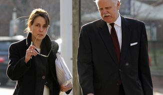 Defense attorneys Rhonda Quagliana, left, and Francis McQ. Lawrence, right, walk into the Charlottesville Circuit courthouse for George W. Huguely V's trial in Charlottesville, Va. on Saturday, Feb. 18, 2012. (AP Photo/Norm Shafer)