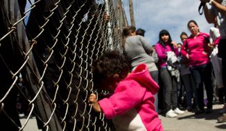 A child cries out for her father as she pushes on a prison gate with police standing on the other side Sunday at a prison on the outskirts of Monterrey, Mexico, that was the scene of deadly rioting. (Associated Press)