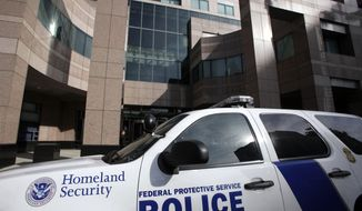 A Homeland Security police car is shown parked outside the Long Beach, Calif., Federal Courthouse.