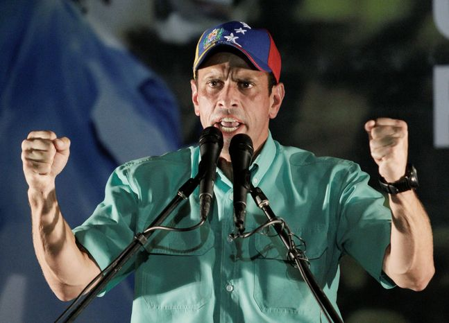 Henrique Capriles delivers a speech after winning the primary. The governor of Miranda state is out to end Hugo Chavez's presidency after 13 years. (Associated Press)