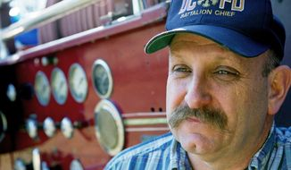 Battalion Chief Richard Sterne may be demoted for reprimanding rather than suspending firefighters who had beer at a station. (Rod Lamkey Jr./The Washington Times)