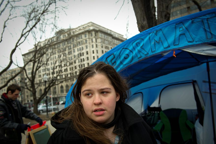 """Antonya Huntenburg, 21, of Hillsborough, N.J., a student at the Corcoran College of Art and Design, says everyone she knows is under some kind of economic pressure, including her parents. She says she joined the Occupy D.C. encampment on McPherson Square """"to be safe."""" (Rod Lamkey Jr./The Washington Times)"""