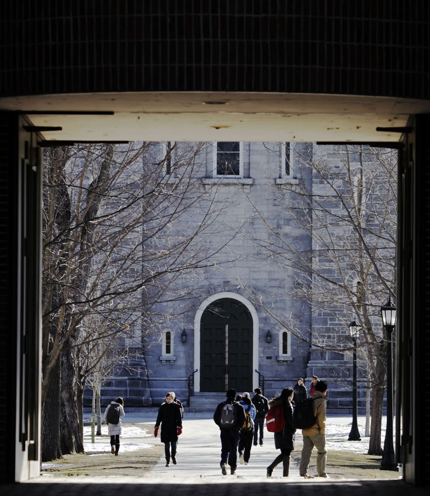 **FILE** People walk on the campus at Bowdoin College in Brunswick, Maine, on Feb. 13, 2012. (Associated Press)