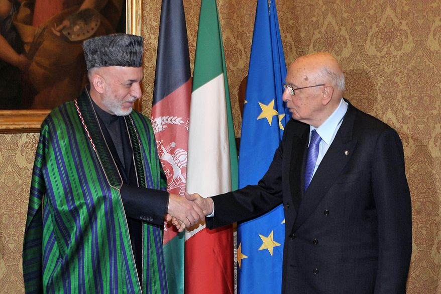 ** FILE ** Afghan President Hamid Karzai (left) is greeted by Italian President Giorgio Napolitano at the Quirinale Palace in Rome on Wednesday, Jan. 25, 2012. (AP Photo/Italian Presidency, Antonio di Gennaro)