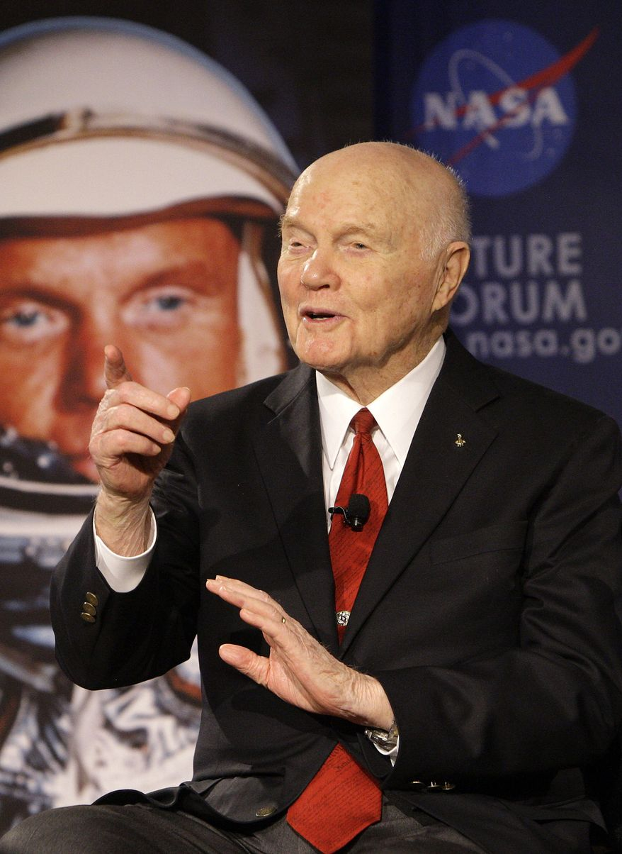 """Sen. John Glenn talks Feb. 20, 2012, via satellite with the astronauts on the International Space Station before the start of a roundtable discussion titled """"Learning from the Past to Innovate for the Future"""" in Columbus, Ohio. (Associated Press)"""
