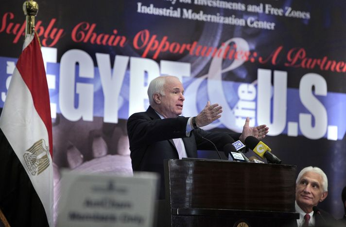 Sen. John McCain, Arizona Republican, speaks to the American Chamber of Commerce in Cairo on Feb. 20, 2012. At right is Apache Chairman and CEO G. Steven Farris. (Associated Press)