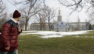 **FILE** A person walks Feb. 15, 2012, on the University at Buffalo campus in Buffalo, N.Y. (Associated Press)