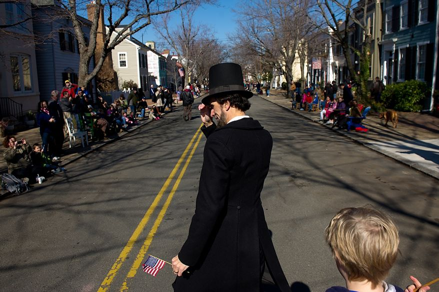 "Dan Storck of Mt. Vernon, VA dressed as President Abraham Lincoln, marches in the George Washington Birthday Parade in Old Town, Alexandria, Va., Monday, Feb. 20, 2012. The Parade which celebrates Washington's 280th Birthday is touted as being the ""largest parade celebrating Washington's birthday in the USA."" (Andrew Harnik/The Washington Times)"