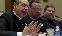 """** FILE ** The Rev. William E. Lori, Roman Catholic bishop of Bridgeport, Conn., gestures while testifying on Capitol Hill in Washington, Thursday, Feb. 16, 2012, before the House Oversight and Government Reform committee hearing: """"Lines Crossed: Separation of Church and State. Has the Obama Administration Trampled on Freedom of Religion & Freedom of Conscience."""" From left are, Lori, the Rev. Dr. Matthew C. Harrison, president of the Lutheran Church Missouri Synod, and C. Ben Mitchell, professor of Moral Philosophy Union University. (AP Photo/Carolyn Kaster)"""