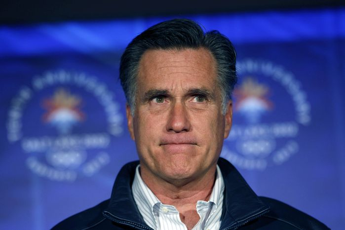 Republican presidential candidate Mitt Romney pauses while speaking to a group of former Salt Lake City Winter Olympics committee members in Salt Lake City on Saturday, Feb. 18, 2012, to mark the 10th anniv