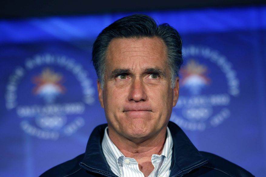 Republican presidential candidate Mitt Romney pauses while speaking to a group of former Salt Lake City Winter Olympics committee members in Salt Lake City on Saturday, Feb. 18, 2012, to mark the 10th anniversary of the games. (AP Photo/Gerald Herbert)