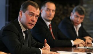 Russian President Dmitry Medvedev (left) meets with leaders of unregistered political parties at the Gorki residence outside Moscow on Monday, Feb. 20, 2012. (AP Photo/RIA-Novosti, Yekaterina Shtukina, Presidential Press Service)