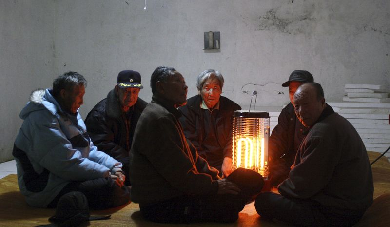 South Koreans gather in an underground shelter on Baengnyeong Island as the country's military began live-fire  drills from front-line islands near its disputed sea border with North Korea on Monday, Feb. 20, 2012. (AP Photo/Yonhap)