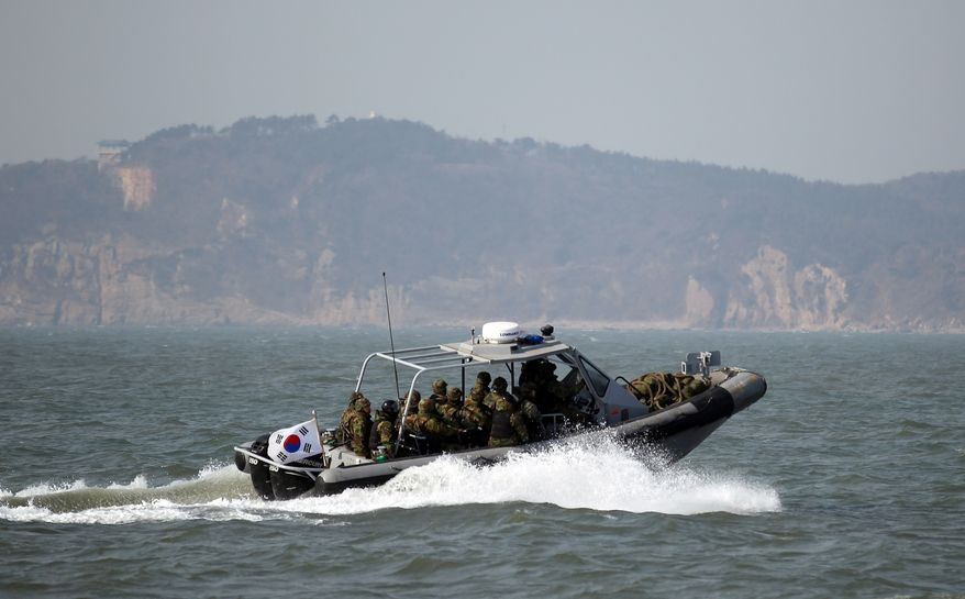 South Korean sailors in a speed boat patrol near the country's Yeonpyong Island after finishing military exercises near the disputed sea border with North Korea on Monday, Feb. 20, 2012. (AP Photo/Yonhap, Bae Jung-hyun)
