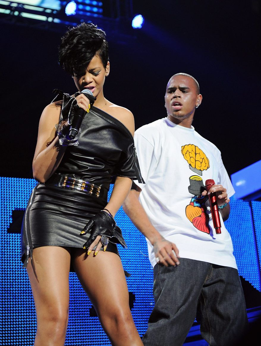 Chris Brown and Rihanna are featured on remixes of each other's hit songs that were released Monday. Mr. Brown attacked Rihanna, his girlfriend at the time, at a pre-Grammy Awards party in 2009. (Associated Press)