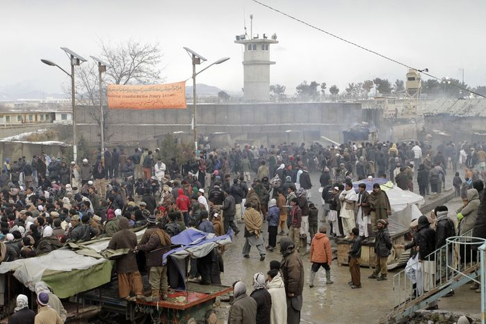 ** FILE ** Afghans demonstrate outside Bagram Air Field, north of Kabul, Afghanistan, on Tuesday, Feb. 21, 2012, to protest the improper disposal and burning of Korans and other Islamic religious materials at the U.S. base. (AP Photo/Musadeq Sadeq)