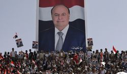 Yemenis rally in Sanaa, Yemen, on Monday, Feb. 20, 2012, for Vice President Abed Rabbo Mansour Hadi (shown in the campaign poster), who is to become president after a vote Tuesday in which he was the only candidate. (AP Photo/Hani Mohammed)