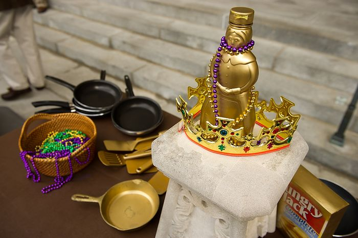 """Golden skillets, a crown, a """"Golden Mrs. Butterworth"""", and beads sit on an awards table before the start of the Washington National Cathedral  Pancake Races held in front of the Cathedral on Shrove Tuesday, more commonly known as """"Mardi Gras."""", Washington, D.C., Tuesday, Feb. 21, 2012. This years annual Pancake Races are entitled the """"Shake, Rattle & Race Edition,†in light of the earthquake damage the cathedral sustained earlier this year. (Andrew Harnik/The Washington Times)"""