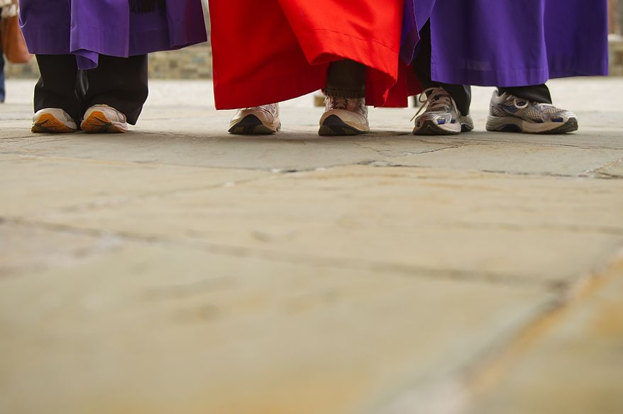 "Left to right: Clergy Associate for Liturgy with the National Cathedral Gina Campbell, the Rev. Canon Ralph Godsall, priest vicar of Westminster Abbey and visiting clergy at the Cathedral, and Rev. Cannon Jan Naylor Cope, Vicar of the National Cathedral, all arrive in tennis shoes for the Washington National Cathedral Pancake Races held in front of the Cathedral on Shrove Tuesday, more commonly known as ""Mardi Gras."", Washington, D.C., Tuesday, Feb. 21, 2012. This years annual Pancake Races are entitled the ""Shake, Rattle & Race Edition,†in light of the earthquake damage the cathedral sustained earlier this year. (Andrew Harnik/The Washington Times)"